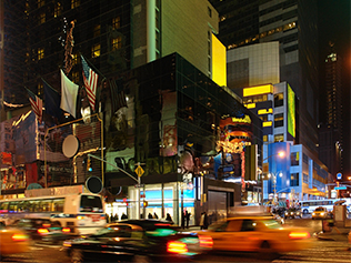 city life with Times Square at night